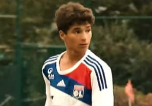 A photo of the 15 year old midfielder playing for the youth systems of Lyon