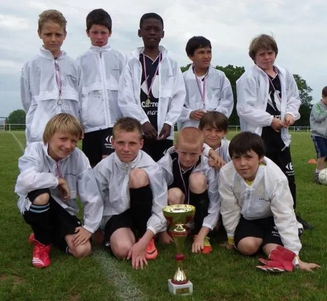 Can you spot him in this team photo
