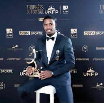 The impressive goalie posing with his Goalkeeper of TheYear award