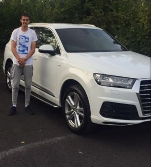 Conor Coady Standing in front of his car
