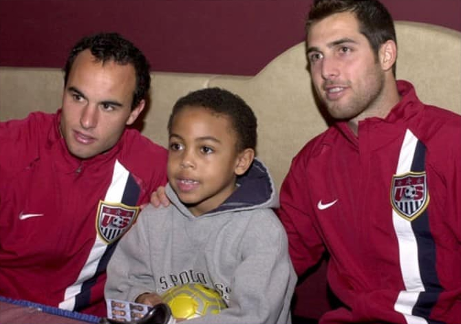Photo of young Mckennie with 2 USMNT legends, Landan Dovona and Carlos Bocanegra.