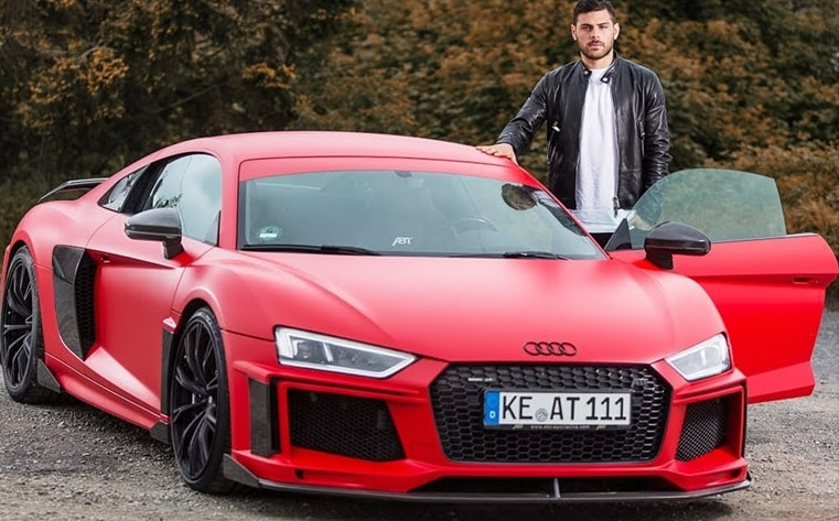 iker showing off one of his fleet of cars.