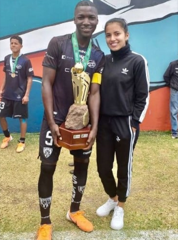 photo of Moises Caicedo and his beautiful.