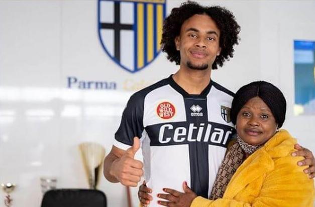 photo of joshua zirkee and his Nigerian mother.
