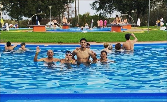 photo of the player and his entire family in a swimming pool.
