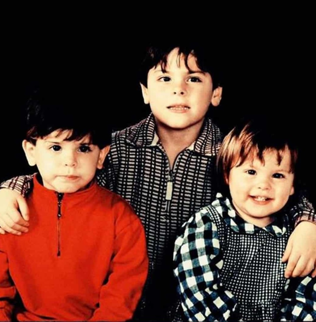 photo of the young footballer with his siblings.