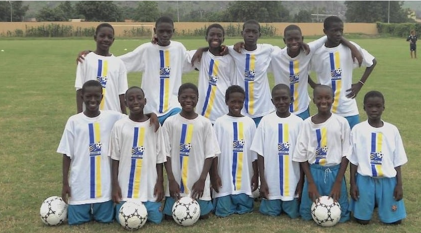 photo of young Yves Bissouma and team mates ( the third person from the right standing)