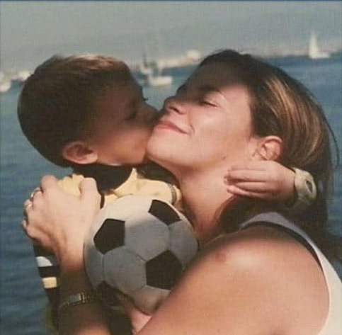 childhood photo of the player and his mother.