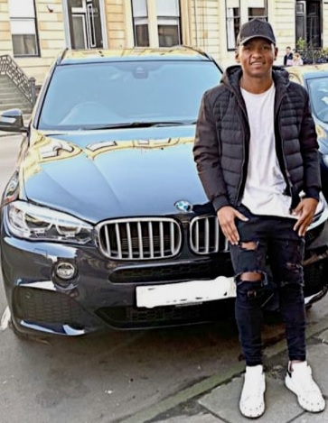 photo of the player close to his car.